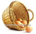 ハンドメイドの自然な柳細工の卵のバスケットは卸し売りする