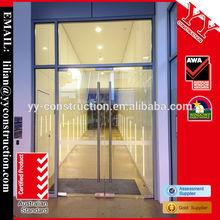 Commercial frameless spring door for shopfront entrance used