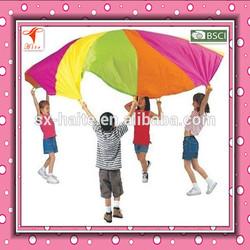 Kids play parachute