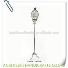 metal standing birdhouse with bird