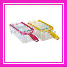 Plastic coconut and cheese grater with food container