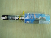 black hand with polybag package lint roller