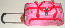 red trolley travel bag