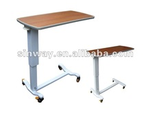 Luxurious wood over bed table with castors