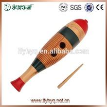 Instrumentos musicales de pescado estilo guiro, De madera