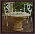 mesa de mármore redonda com cadeiras