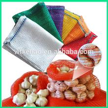 knitted orange mesh plastic bag