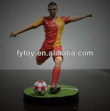miniature soccer player figure
