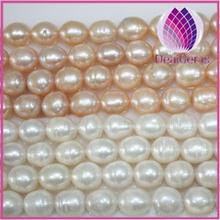 Natural Pearl white / peach / mauve 9-10mm rice,B+ grade.