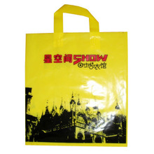 Two long Handles yellow color hdpe plastic bags