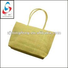 yellow reusable straw shopping bag