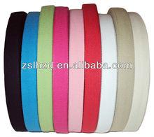 White herringbone cotton webbing belt roll