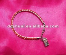 Braided leather bracelet with enamel and crystal bus