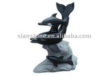 piccola scultura in pietra delfino