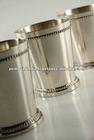 julep cup/metal center piece/flower arrangement on wedding table julep cup