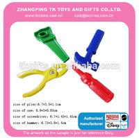 four plastic mini magnetic tool toys