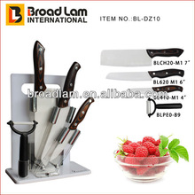 Deluxe ceramic kitchen knife set with wooden handle in acrylic stand, with plastic chopping board in a set