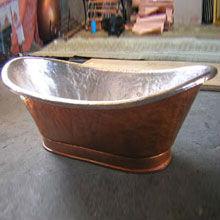 copper bathtub with silver plated interior
