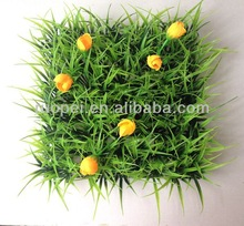 Artificial green turf grass with flowers for landscape