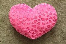 Heart-shaped plush cushion