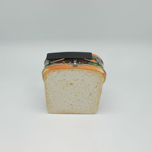 Tin box in the shape of bread with printing and beautiful picture for saving food