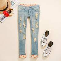 Free shipping korea design women's Slim Jeans Pencil Pants Polka Dot Hole Crimping denim trousers Female