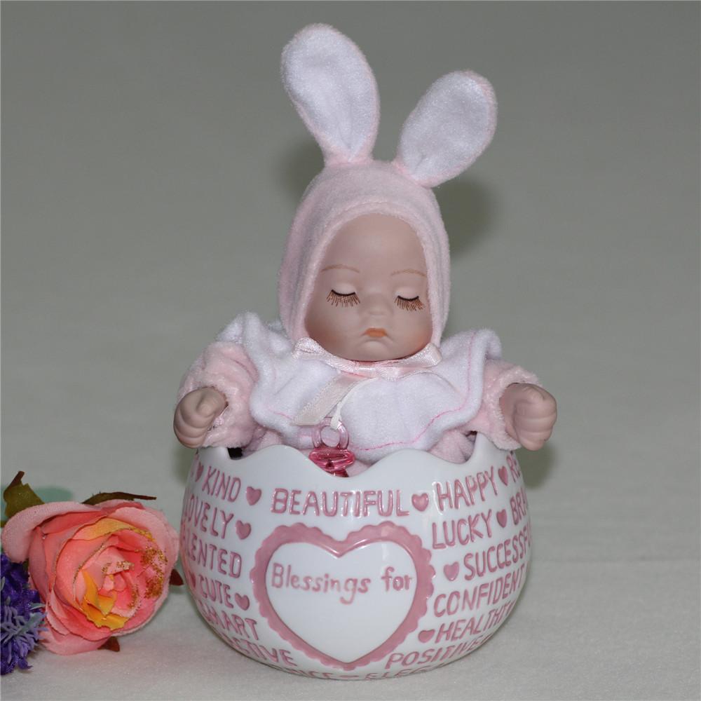 Presente do dia grátis frete bebê música boneca de cerâmica presente caixa coelho(China (Mainland))