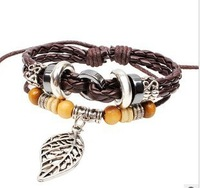 In 2013 new style leather bracelet beads beads bracelet with a green leaf leather braided bracelet Bohemian