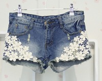Free shipping Summer new women's clothing lace pearl decoration hole jeans fashion casual denim shorts