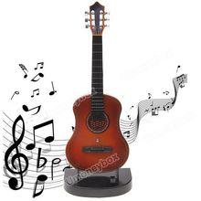 Free Shipping  High Quality Fashion Fun Mini Guitar Toy for Kids Music Sound Toy(China (Mainland))