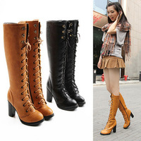 Autumn and winter  round toe rivet cross straps boot for women.medium long ladies fashion boots