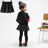 NEW 2013 autumn leather skirt kid's skirt solid color all-match expansion bottom child leather skirt miniskirt free shipping
