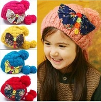 2014 New Hot Child Knitted Skullies Princess Beanies Fashion Bow Tie Buttons Ear Protector Twist Cap Autumn And Winter Hats