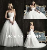 simple and understated satin bodice tulle skirt strapless ruched natural waistline designer wedding dresses