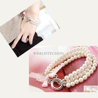 W7Tn Fashion Pearl Chain Rhinestone Bracelet Bangle with Peace Trumpet Pink Bow