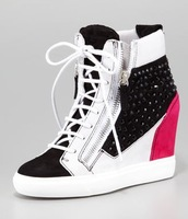 Crystal Colorblock Wedge Sneaker Colorblock suede upper covered in faceted crystals Lace-up vamp; gored off-center