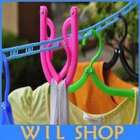 Free shipping Hot sale Simple colorful plastic portable Folded Travelling Hangers Easy To Take clothes rack
