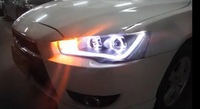 Mitsubishi wing God dual angel eyes LED headlight assembly photoconductive tears bifocal lens xenon headlight assembly
