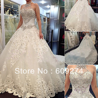 2014 Vintage SWAROVSKI Wedding Dresses Halter Tulle Crystals Bow Appliques Lace Up Long Cathedral Train Backless Bridal Gowns