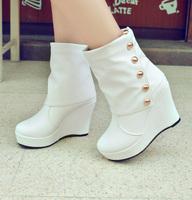 2014 autumn and winter fashion rivet boots high heel wedges platform boots women's shoes medium-leg boots
