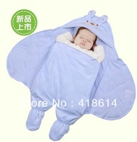Newborn infant ploughboys holds velvet baby bear autumn and winter sleeping bag