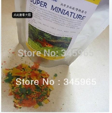 Free shipping Tropical Fish extreme brightening flake fish food 150g(China (Mainland))