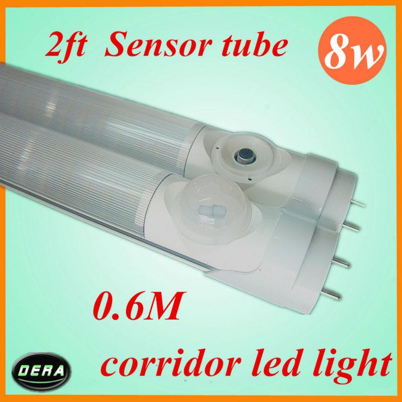 Free shipping 25pcs 8W T8 led sensor tube Human sensor 600mm led tube 650-850lm 85-265v Body IR induction sensor light(China (Mainland))