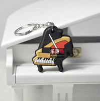 Music 3d stereo double faced multicolour piano keychain . music key ring