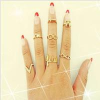 Min.order is $10(Mix order)Free Shipping! Artilady 2013 Fashion 7pcs Stacking Midi Rings Infinite Love Deisgn Women Jewelry