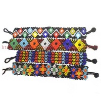 .Free shipping 12pcs mixed /lot stretch Popular Glass Seedbead Friendship Hipanema bracelet