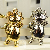 free shipping 2pcs Car keychain ingot cattle three-dimensional key ring gold silver ingot lucky cattle key chain