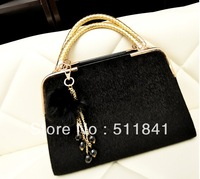 The new women's PU handbag shoulder bag bag pendant horse hair black, blue