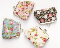 Free shipping the new fashion women small rose flower cloth change to receive a package, holding the key packet