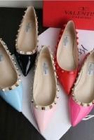 2014 New fashion spring rivet left bank of the rivet pointed toe flat bottom flat heel women's single shoes woman Free shipping